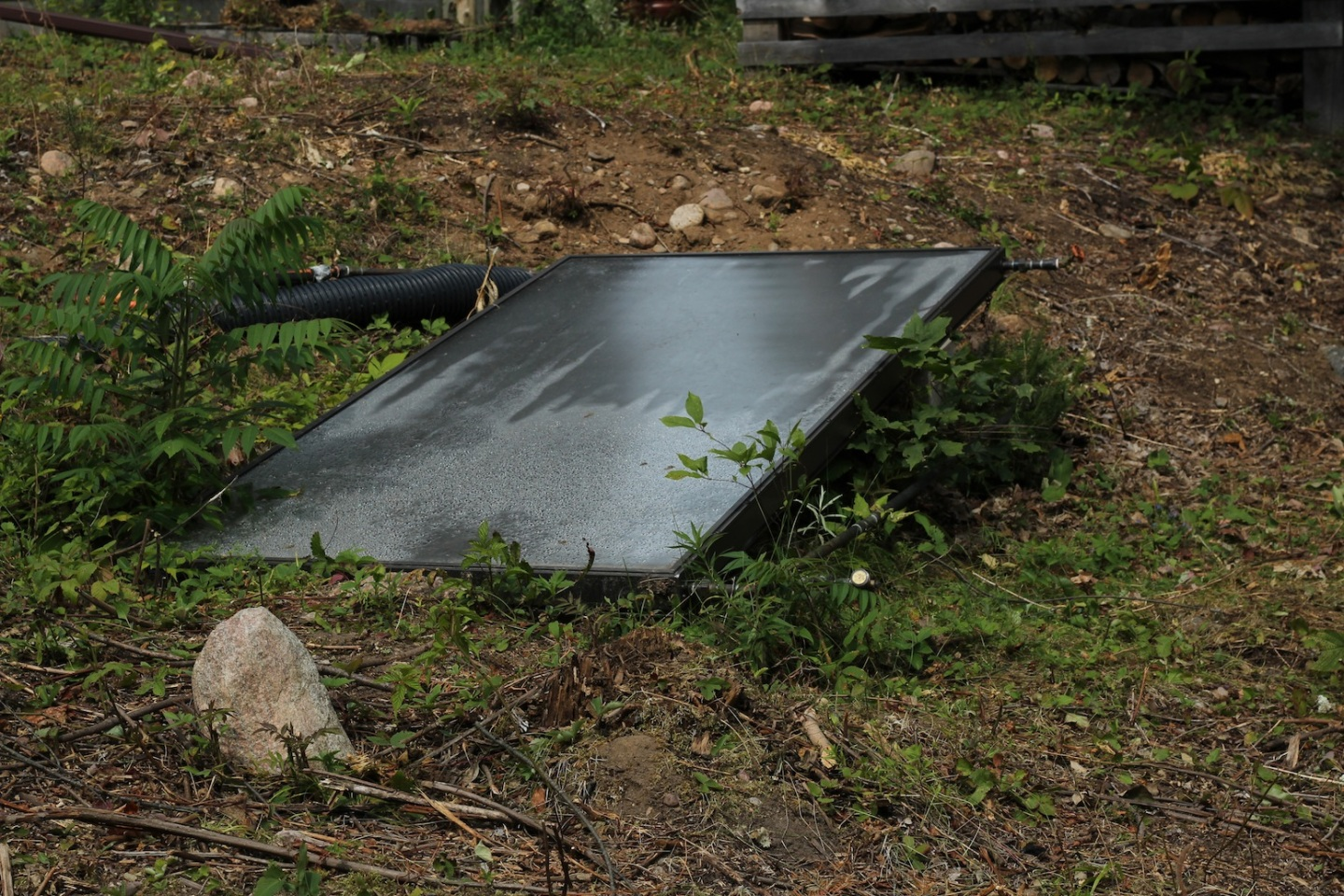 The old passive solar panel lying on the ground.