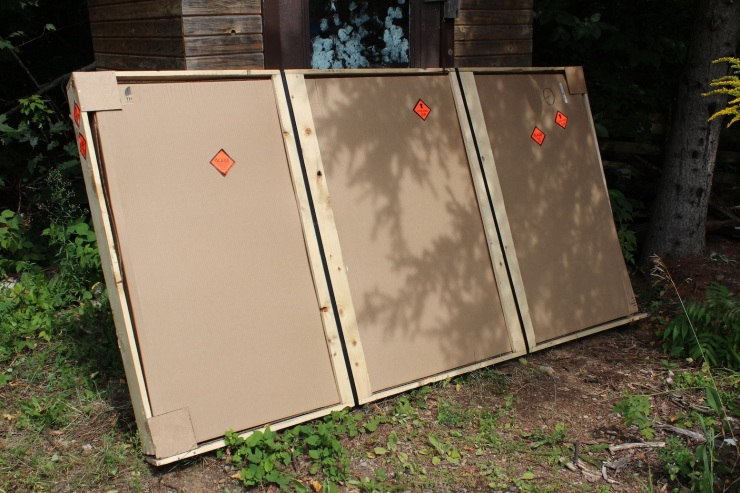Cardboard and wood packing around the new solar panel