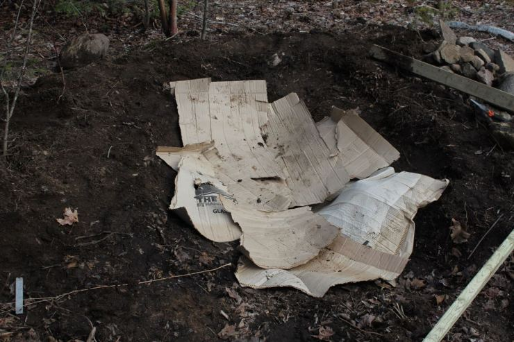 Cardboard lining the main part of the pond