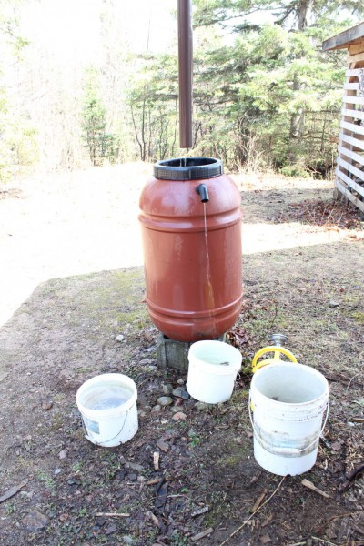 Rain barrel fed from downspout that is overflowing
