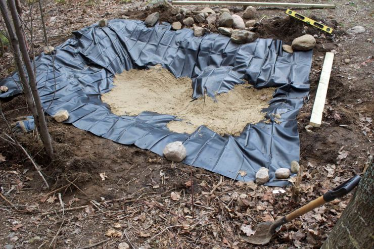 Sand in the base of the pond liner